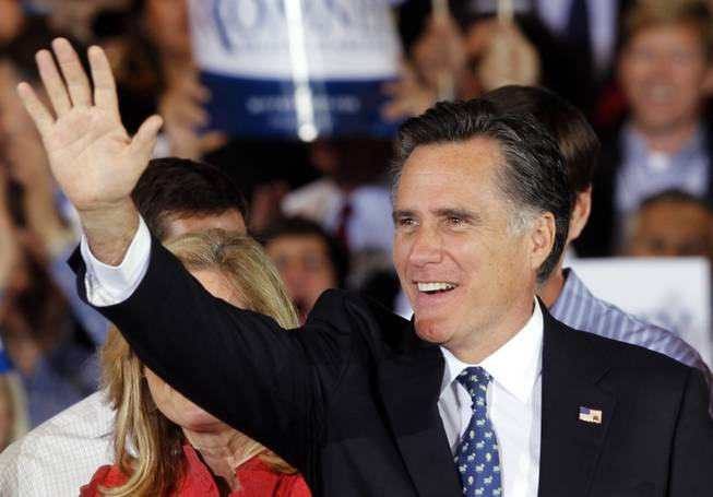 Republican presidential candidate Mitt Romney waves to supporters during his victory celebration after winning the Florida primary election Tuesday, Jan. 31, 2012, in Tampa, Fla.