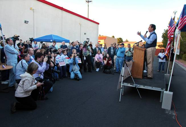 Republican presidential candidate former Pennsylvania Sen. Rick Santorum speaks during rally outside his Nevada headquarters in Las Vegas on Tuesday, Jan. 31, 2012.