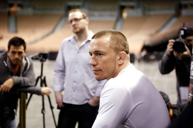 Georges St. Pierre talks with the media during open workouts for UFC 143 at Mandalay Bay Events Center in Las Vegas on Wednesday, Feb. 1, 2012.