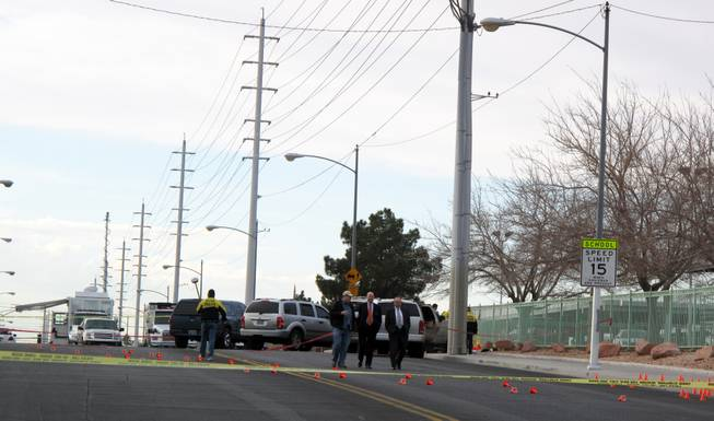 A homicide suspect who shot a Metro Police detective died early Wednesday morning after authorities returned fire, striking and killing him, police said. The officer-involved shooting happened near Washington Avenue and Michael Way in the northwest valley. The injured officer is in stable condition at University Medical Center.