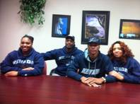 Las Vegas High quarterback Hasaan Henderson poses for a picture with his family (dad Alzim Henderson, mom Kishombi Henderson and sister Mykiera Henderson) after signing a national letter of intent Feb. 1, 2012, to play football at Nevada.