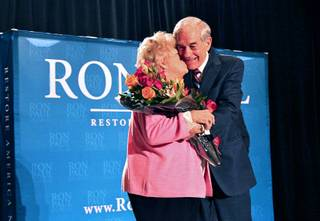 Republican presidential candidate U.S. Rep Ron Paul (R-TX) gets a kiss from his wife Carolyn during a campaign event at the Four Seasons Las Vegas Wednesday, February 1, 2012. It is their 55th wedding anniversary today.