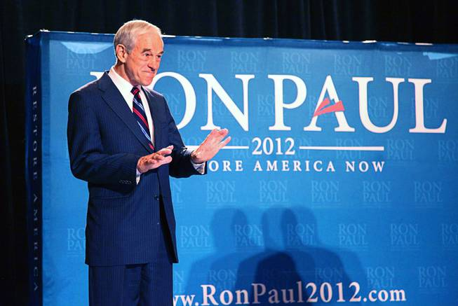 Republican presidential candidate U.S. Rep. Ron Paul, R-Texas, gestures for the audience to settle down after taking the stage during a campaign event at the Four Seasons Las Vegas on Wednesday, Feb. 1, 2012.