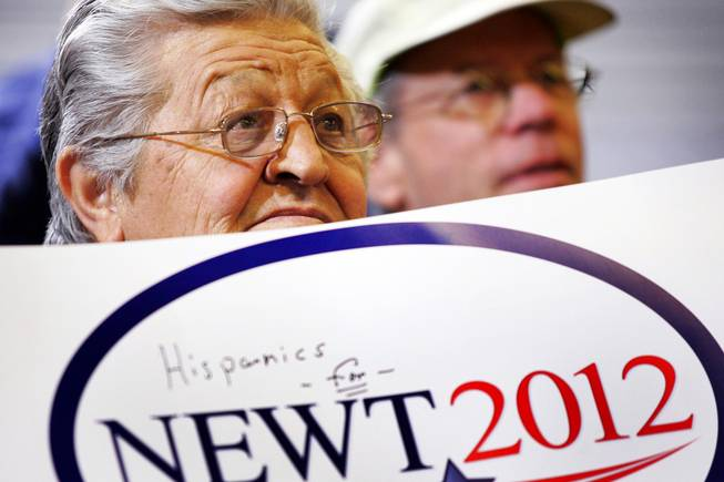 A supporter watches as former House speaker Newt Gingrich speaks during a rally at Xtreme Manufacturing in Las Vegas Thursday, Feb. 2, 2012.