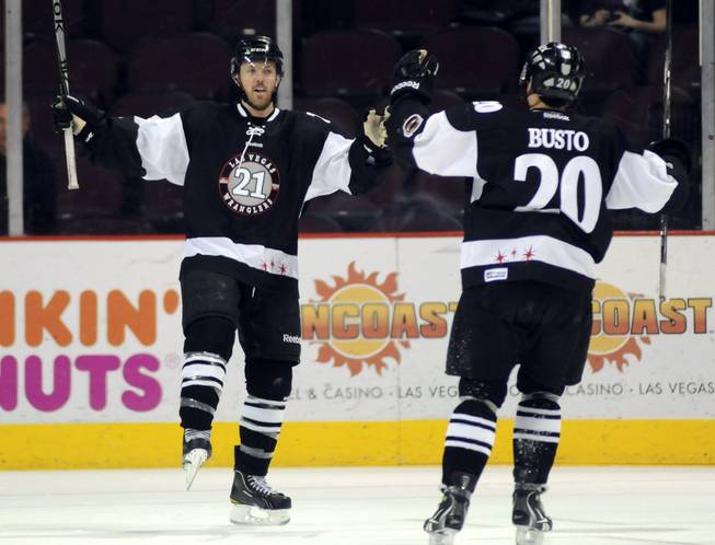 Josh Lunden, (21) celebrates with teammate Michael Busto, right, after scoring a first period goal against the Alaska Aces on Thursday night.