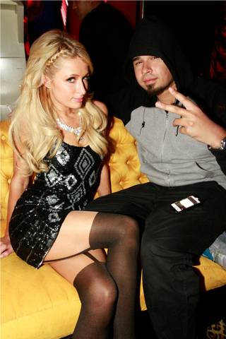Paris Hilton and DJ Afrojack at Surrender on Friday, Feb. 3, 2012.