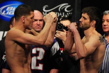 Nick Diaz and Carlos Condit face off during the weigh in for UFC 143 Friday, Feb. 3, 2012 at Mandalay Bay.