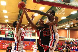 Valley High School's Hasaan Henderson drives to the basket against  Las Vegas High school during their game Friday, Feb. 3, 2012 at Valley.