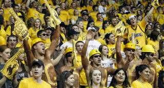 Wyoming fans cheer during the Cowboys' game Saturday, Feb. 4, 2012, against UNLV in Laramie, Wyo.