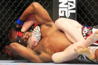 Clifford Starks finds himself in a rear naked choke from Ed Herman in the second round of their fight at UFC 143 Saturday, Feb. 4, 2012 at the Mandalay Bay Events Center.