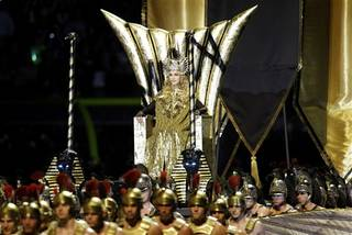 Madonna performs during halftime of the NFL Super Bowl XLVI football game between the New York Giants and the New England Patriots, Sunday, Feb. 5, 2012, in Indianapolis. (AP Photo/Matt Slocum)