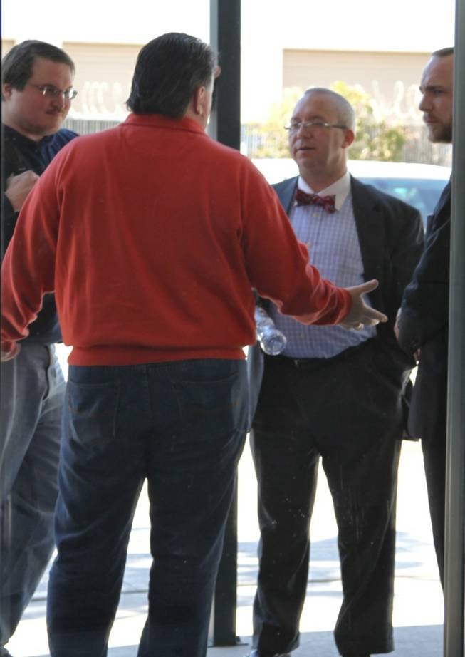 Michael McDonald, who is running to be chairman of the Nevada GOP, gestures and talks with lawyers and representatives for Ron Paul outside the Clark County GOP headquarters in Las Vegas, where party officials were having intense discussions with the presidential campaigns about the still-unreleased results of the Nevada caucuses Sunday morning.