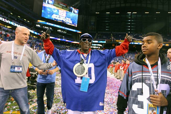 Henderson resident Flavor Flav celebrates the New York Giants victory against the New England Patriots at Super Bowl XLVI at Lucas Oil Stadium in Indianapolis on Tuesday, Feb 5, 2012.