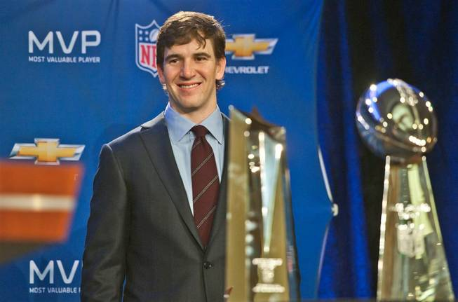 New York Giants quarterback Eli Manning is presented with the Super Bowl XLVI MVP trophy in Indianapolis on Monday, Feb. 6, 2012. NFL Commissioner Roger Goodell and Giants coach Tom Coughlin attended the presentation.