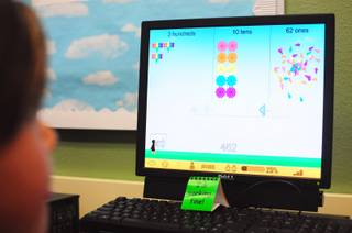 Sewell Elementary School student works through a lesson on place values using the