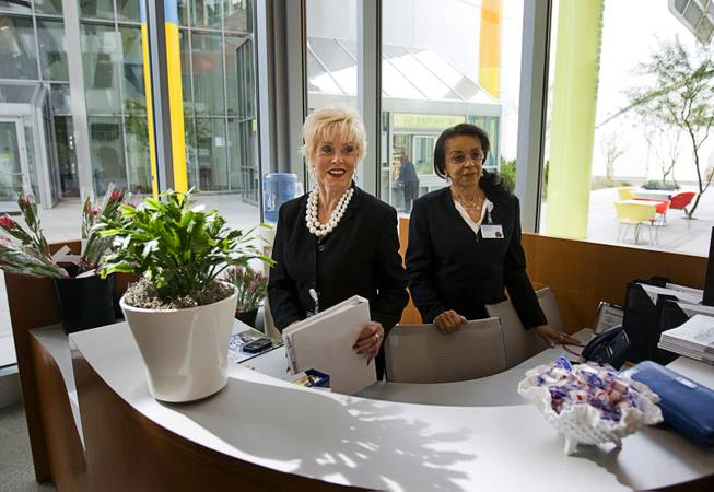 Volunteers Jan Shaw, left, and Barbara Briscoe man the lobby desk at the Cleveland Clinic Lou Ruvo Center for Brain Health Tuesday, February 7, 2012.