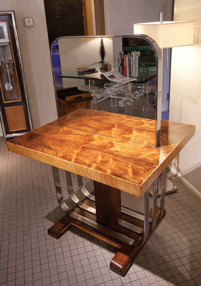 An art deco table once used in a milliner store is in the home of Steve Evans.