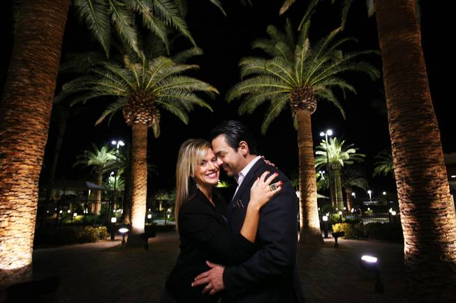 Amber Anderson and Cesar Salas pose near their home in Rhodes Ranch in Las Vegas on Friday, Feb. 10, 2012.
