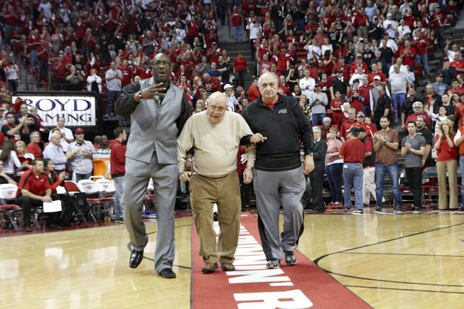 Former UNLV head coach Jerry Tarkanian and other members of the 1986-1987 Final Four Rebels team are honored at halftime of the UNLV game against San Diego State Saturday, Feb. 11, 2012. At left is Eldridge Hudson, a power forward on the legendary team.
