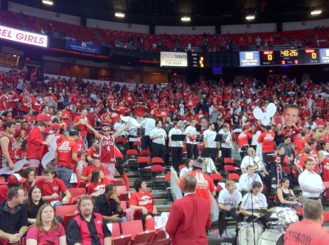 The student section at the UNLV-San Diego State game. There are a million stories up there ... and a dozen big heads.