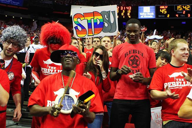 Rapper Flavor Flav joins the UNLV student section during their Mountain West Conference game  against San Diego State Saturday, Feb. 11, 2012 at the Thomas & Mack Center. UNLV won the game 65-63.