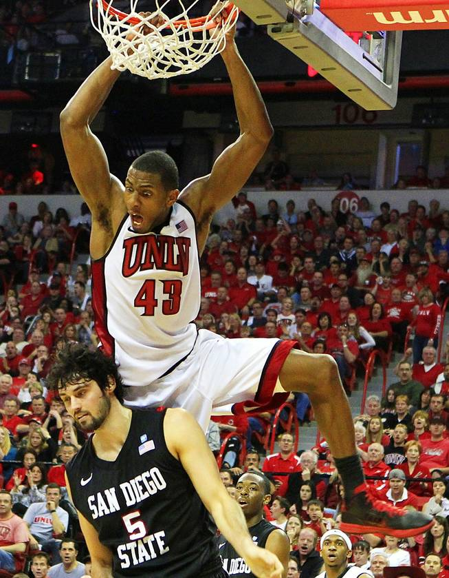 UNLV forward Mike Moser dunks on San Diego State forward Garrett Green during their Mountain West Conference game Saturday, Feb. 11, 2012 at the Thomas & Mack Center. UNLV won the game 65-63.