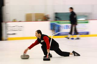 Curling instructor Nick Kitinski shows his curling form as he releases a stone during an open practice session of the Las Vegas Curling Club at the Las Vegas Ice Center on West Flamingo Road on Feb 12, 2012.