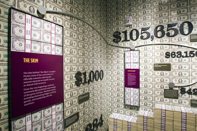 "Stacks of fake money are displayed in the ""Skim Room"" at the Mob Museum in downtown Las Vegas Monday, Feb. 13, 2012. The Skim Room details how mobsters skimmed money (pocketing money before it was officially counted) from Las Vegas casinos. The museum, in a renovated former federal courthouse and U.S. Post Office, will have its grand opening Tuesday."