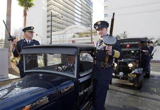 Members of the San Diego Police Museum Association pose on a 1928 Ford Model A before the Mob Museum's grand opening in downtown Las Vegas, Tuesday February 14, 2012. The building, a former federal courthouse and post office, was completed in 1933 and is listed on the Nevada and National Registers of Historic Places. It is also one of 14 sites in the nation that hosted the 1950-51 U.S. Senate Special Committees to investigate Crime in Interstate Commerce, also known as the Kefauver hearings.