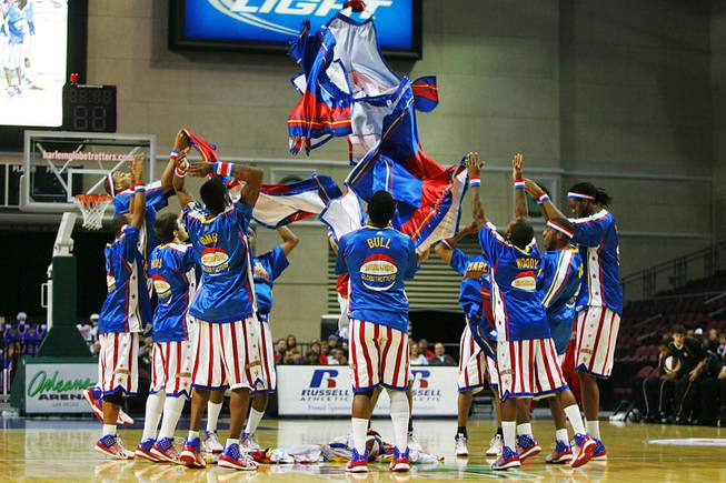 The Harlem Globtrotters throw their warm ups in a pile at the Orleans Wednesday, Feb. 15, 2012.