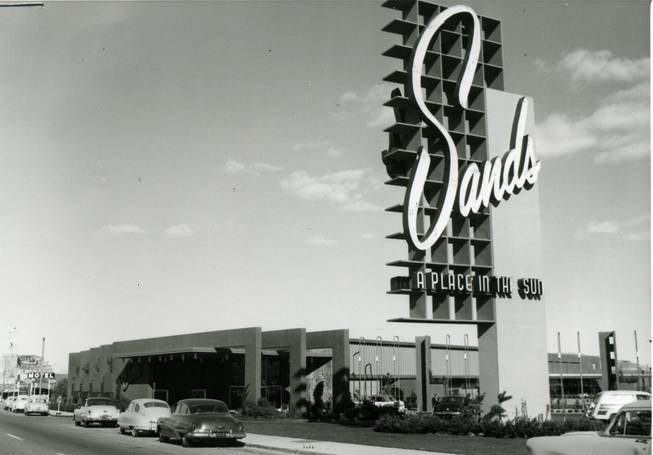 Cars line the Las Vegas Strip in front of the Sands casino in this 1950s photo.