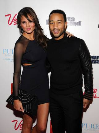 Chrissy Teigen and John Legend arrive at Pure in Caesars Palace on Thursday, Feb. 16, 2012.