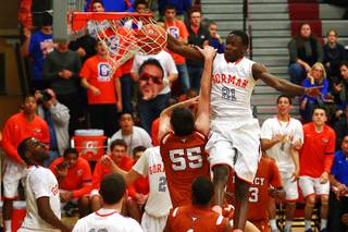 Bishop Gorman's Demetris Morant dunks on Legacy center Chris Hughes during their Sunset Regional semifinal game Thursday, Feb. 16, 2012. Gorman won 73-43.