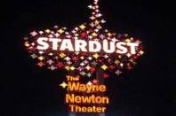 A photo of the old Stardust sign advertising the Wayne Newton Theater.