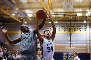 Devan Kohn of Green Valley, left, and Darren Buckles of Foothill fight for a rebound during the Sunrise Regional Championships at Foothill High School in Henderson on Friday, Feb. 17, 2012.