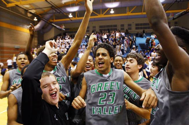 Green Valley celebrates after beating Foothill during the Sunrise Regional Championships at Foothill High School in Henderson on Friday, Feb. 17, 2012.