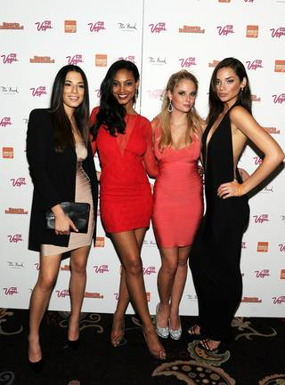 Jessica Gomes, Ariel Meredith, Genevieve Morton and Michelle Vawer arrive at the Sports Illustrated Overtime after-party at the Bank in the Bellagio on Thursday, Feb. 16, 2012.