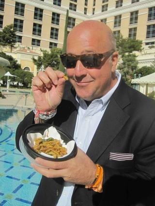 Andrew Zimmern, with crispy fried buttered worms, films at the Bellagio on Friday, Feb. 17, 2012.