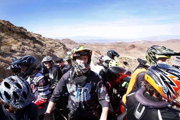 Riders take the shuttle up to the top of the canyon during Reaper Madness at Bootleg Canyon in Boulder City on Saturday, Feb. 18. 2012.