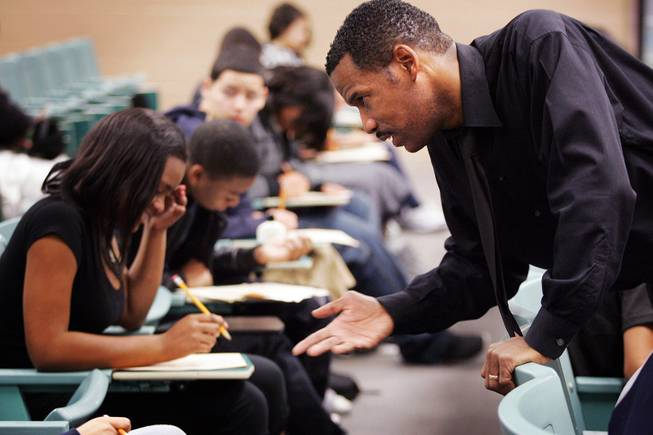 Teacher Todde Webb helps students during School on Saturday at Mojave High School in North Las Vegas on Saturday, Feb. 18, 2012.