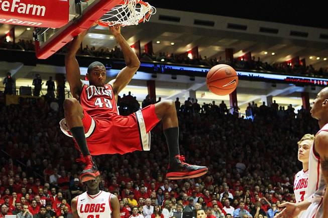 UNLV forward Mike Moser dunks on New Mexico during the first half of their game Saturday, Feb. 18, 2012 at The Pit in Albuquerque, N.M.