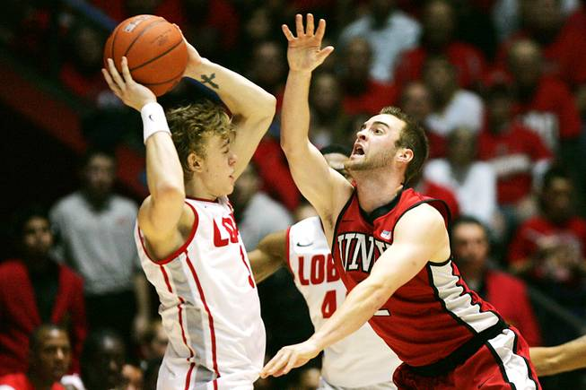 UNLV guard Kendall Wallace defends New Mexico guard Hugh Greenwood during their game Saturday, Feb. 18, 2012 at The Pit in Albuquerque, N.M. New Mexico won 65-45 to take sole possession of first place in the Mountain West.