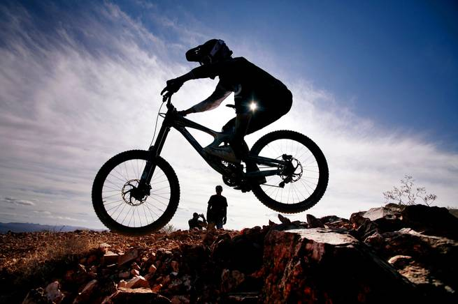 A rider competes in the Downhill at Reaper Madness at Bootleg Canyon in Boulder City on Sunday, Feb. 19, 2012.