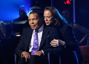 "Boxing legend Muhammad Ali and his wife Lonnie Ali appear onstage during Keep Memory Alive's ""Power of Love Gala"" celebrating Muhammad Ali's 70th birthday at MGM Grand Garden Arena on Saturday, Feb. 18, 2012. The event benefits the Cleveland Clinic Lou Ruvo Center for Brain Health and the Muhammad Ali Center."