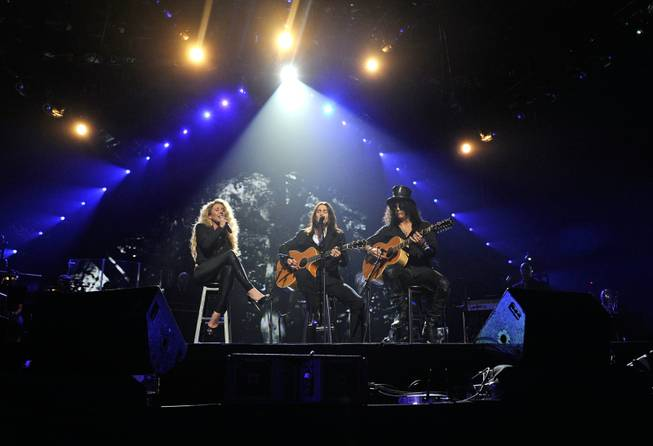"LAS VEGAS, NV - FEBRUARY 18:  (EXCLUSIVE COVERAGE)  Singer Haley Reinhart, musician Myles Kennedy and recording artist Slash perform onstage at the Keep Memory Alive foundation's ""Power of Love Gala"" celebrating Muhammad Ali's 70th birthday at the MGM Grand Garden Arena February 18, 2012 in Las Vegas, Nevada. The event benefits the Cleveland Clinic Lou Ruvo Center for Brain Health and the Muhammad Ali Center.  (Photo by Ethan Miller/Getty Images for Keep Memory Alive)"