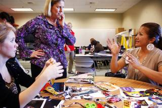 Teacher Leanne Candeloro, center, talks with students Kate Johnson, left, and Lucy Grossi during occupational therapy class at College of Southern Nevada Charleston campus in Las Vegas Wednesday Feb. 22, 2012.