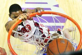 UNLV forward Quintrell Thomas throws down a put back dunk against Boise State during their game Wednesday, Feb. 22, 2012 at the Thomas & Mack Center. UNLV won the game 75-58.