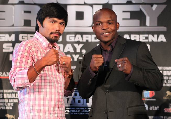 WBO welterweight champion Manny Pacquiao, left, and undefeated WBO junior welterweight champion Timothy Bradley Jr. pose during a press conference in New York City Thursday during a cross-country media tour for their upcoming welterweight title fight. Pacquiao vs Bradley will take place June 9 at the MGM Grand Grand Garden Arena in Las Vegas.