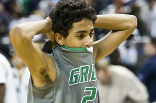 Green Valley High's Lorenzo Jarvis stands in disbelief at midcourt after the Gators' 70-68 loss to Northern Nevada's Hug High in the 4A state semifinals at Lawlor Events Center in Reno on Feb. 23, 2012.