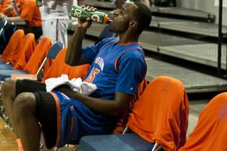 Bishop Gorman High's Shabazz Muhammad rehydrates on the sideline during the Gaels' 96-51 win over Northern Nevada's Hug High in the state championship game at Lawlor Events Center in Reno.
